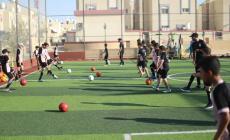 مسلم ومحمد هربا من البطالة بتعليم الأطفال كرة القدم