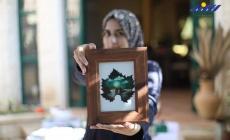 الفنانة لين الحاج تحول أوراق العنب إلى لوحات فنية