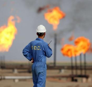 Iraqi-oil-worker-speaks-on-a-radio-transciever-at-an-oil-refinery-in-the-southern-town-Nasiriyah.jpeg