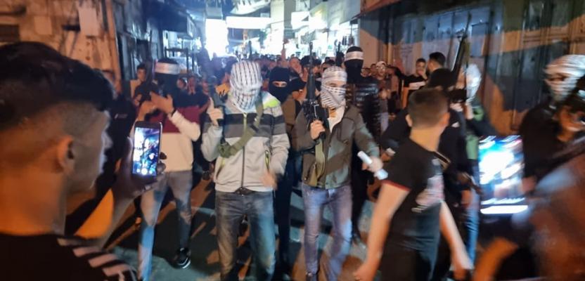 مسيرة ليلية في مخيم بلاطة دعماً لغزة